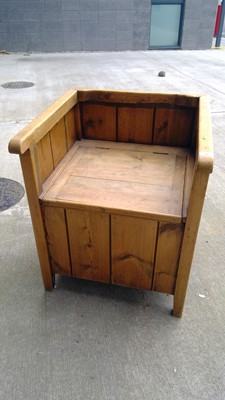 Lot 11 - An unusual pine commode with original ceramic...