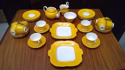 Lot 6 - An Aynsley yellow ground porcelain tea service...