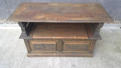 Lot 1 - An oak monks bench with stylised lion...