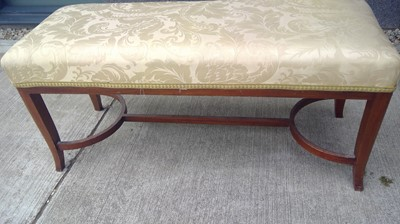 Lot 10 - An upholstered duet stool with wishbone...