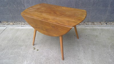 Lot 9 - An Ercol drop leaf table, top loose, height...