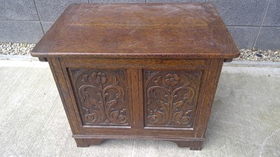Lot 15 - An oak carved chest, height 60cm width 75cm...
