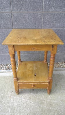 Lot 20 - A late 19th-century pine two-tier table with a...