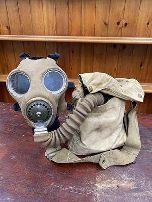 Lot 12 - A WWII gas mask made by Siebe, Gorman & co ltd.
