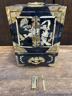 Lot 11 - A Chinese lacquered table cabinet.