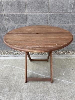 Lot 17 - A circular wooden garden table, height 74cm x...