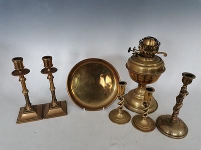 Lot 88 - A brass oil lamp, six brass candlesticks, and...