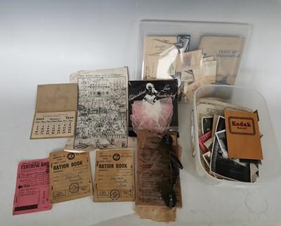 Lot 96 - WWII anti-gas eye shields, ration books, a...