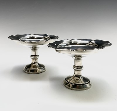 Lot 33 - A pair of filled silver bonbon stands...