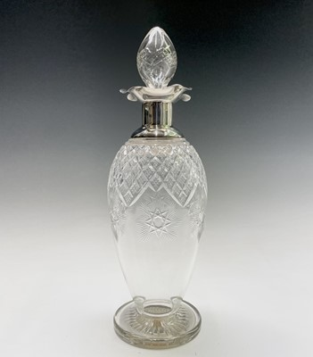 Lot 34 - A good cut glass ovoid footed decanter with...