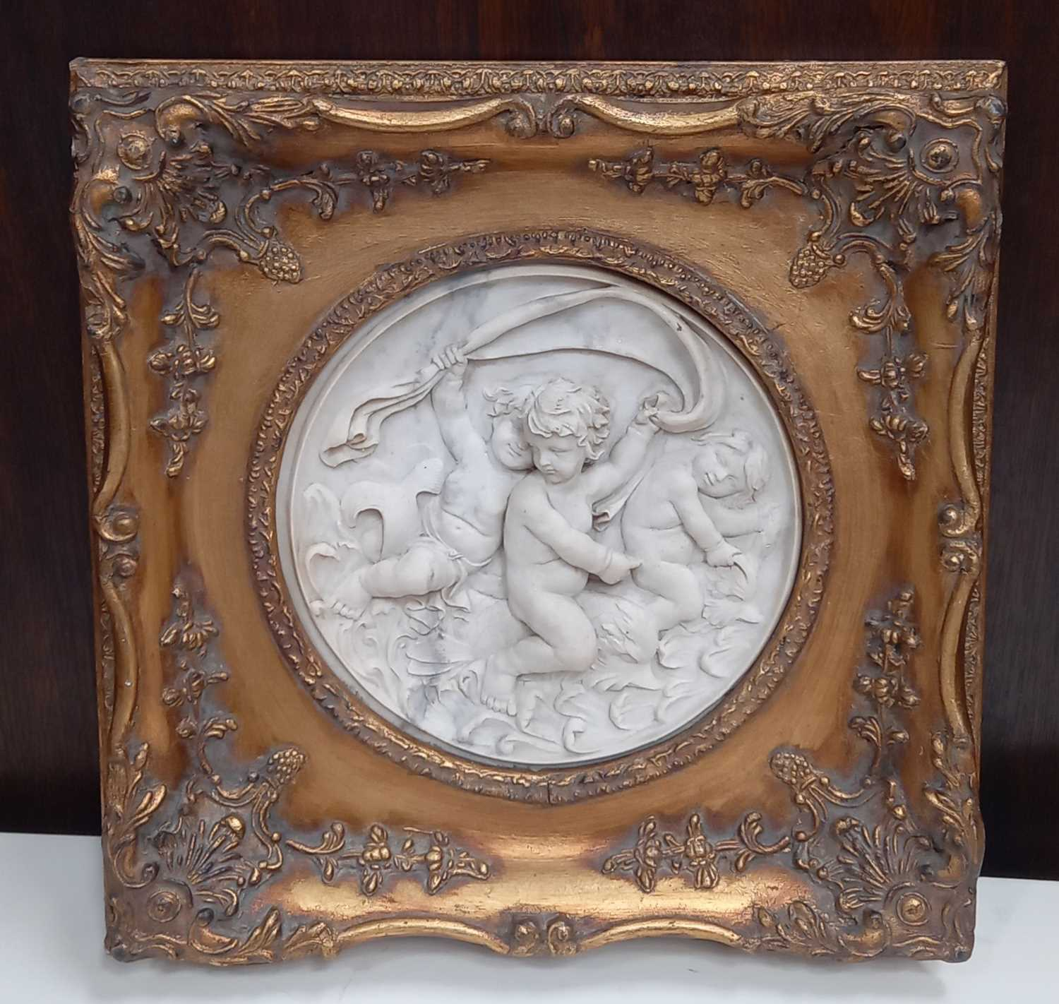 Lot 7 - A plaque in ornate gilt frame, bearing a...