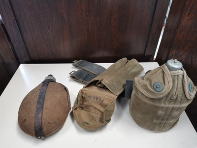 Lot 55 - Two WWII era flasks with belt.