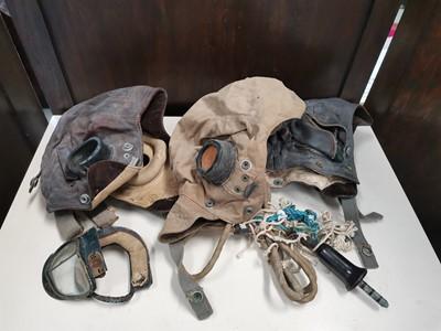 Lot 56 - Three WWII era fliying helmets.