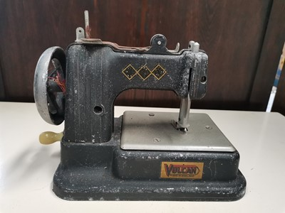 Lot 59 - A vintage 'Vulcan' toy sewing machine.