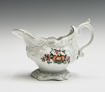 Lot 804 - A Plymouth porcelain rococo sauceboat, William...