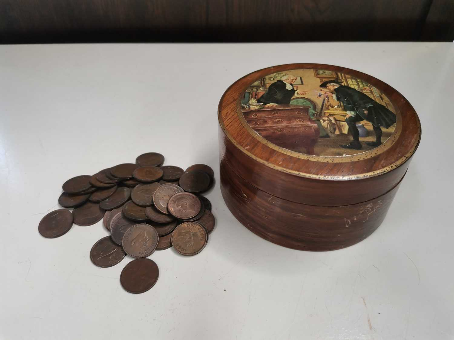 Lot 24 - Fifty farthings in an antique metal lined...