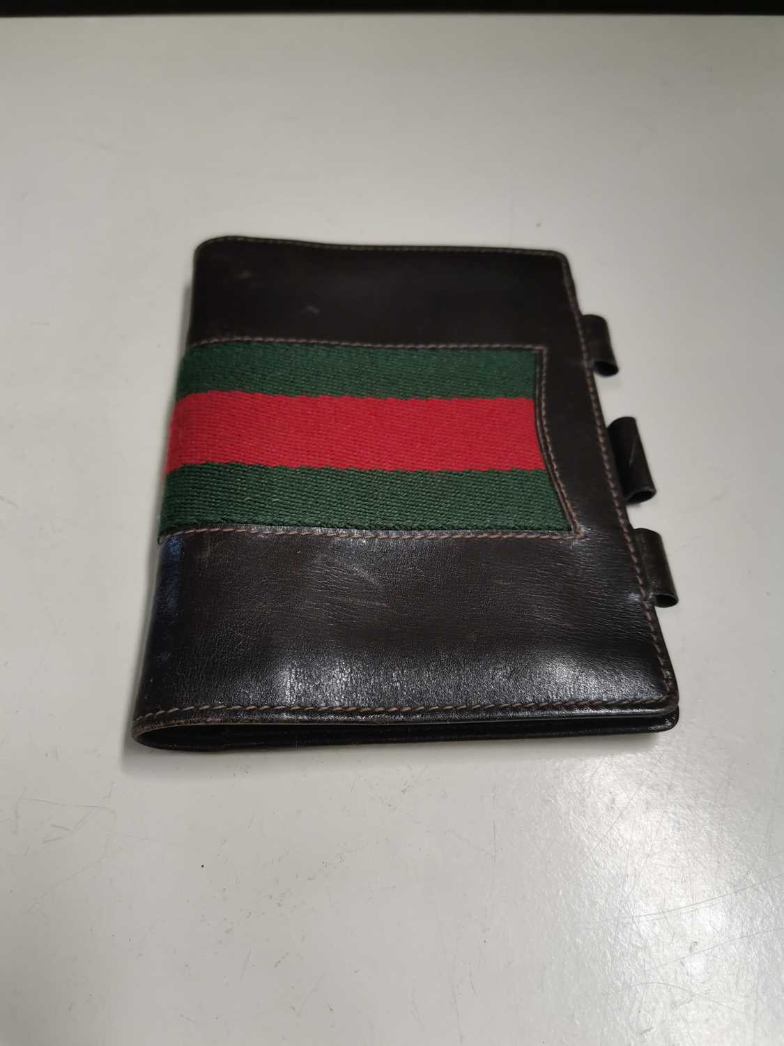 Lot 18 - A 'Gucci' leather notebook.