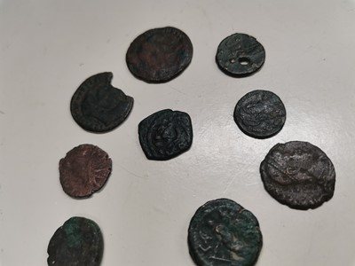 Lot 36 - Nine Roman coins with one Greek coin.