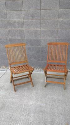 Lot 11 - Two teak folding garden chairs.