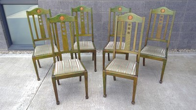 Lot 15 - Six stained Arts and Crafts oak dining chairs.
