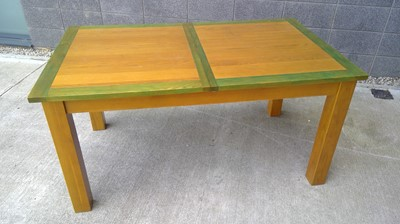Lot 16 - A modern oak extending table, height 75cm...