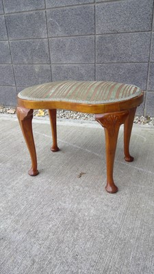 Lot 13 - A 19th-century walnut stool on cabriole legs...