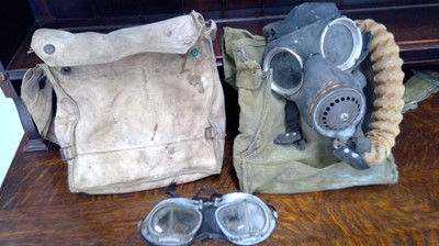 Lot 7 - A Gas Mask respirator bag and mask, possibly...