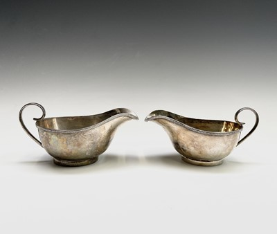 Lot 37 - A pair of George V silver sauce boats by...