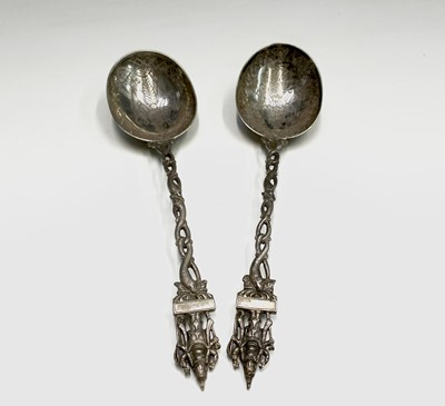 Lot 39 - A pair of Indian silver deity spoons 21cm 139.3gm