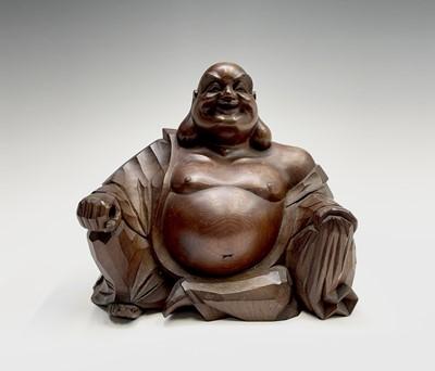 Lot 305 - A Japanese boxwood figure of a seated Buddha,...
