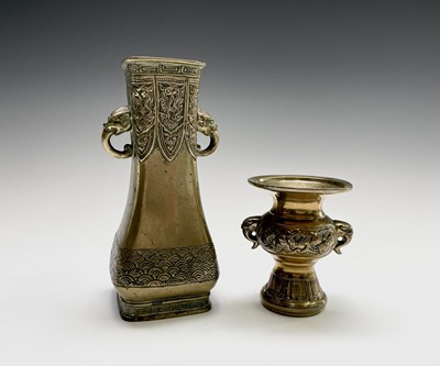 Lot 307 - A Chinese brass vase, 19th century, with twin...