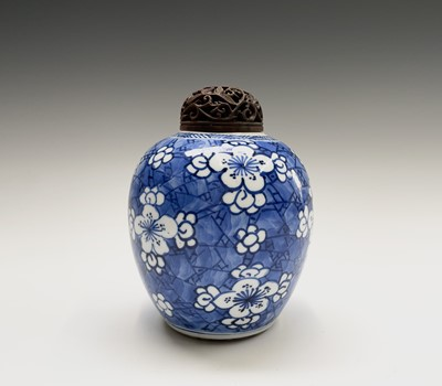 Lot 312 - A Chinese porcelain blue and white prunus...