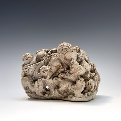 Lot 321 - A Chinese carved white stone group, circa 1900,...