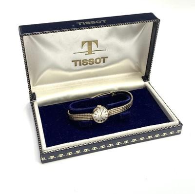 Lot 2 - A ladies 9ct gold Tissot wristwatch on 9ct...
