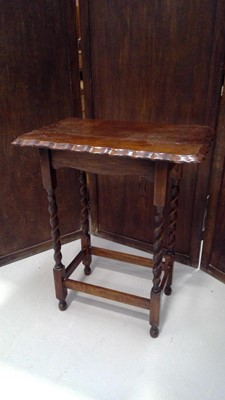 Lot 10 - An oak side table with barley twist legs and...