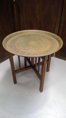 Lot 19 - A brass Benares table, height 52cm diameter 57cm.