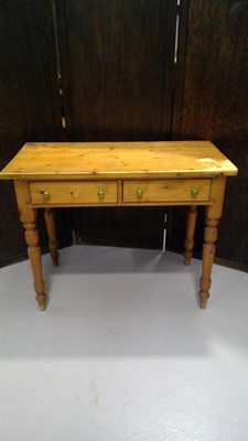 Lot 22 - A pine side table with two drawers, height...