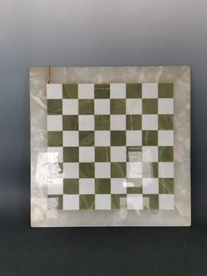 Lot 11 - An onyx chess board, 45x45cm.
