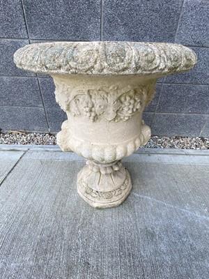 Lot 6 - A stone composite urn shaped garden planter,...