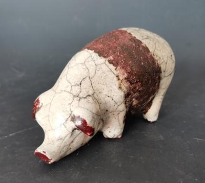 Lot 10 - A Raku pig sculpture, height 7cm.