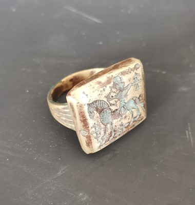Lot 14 - A large antique bronze ring depicting an...