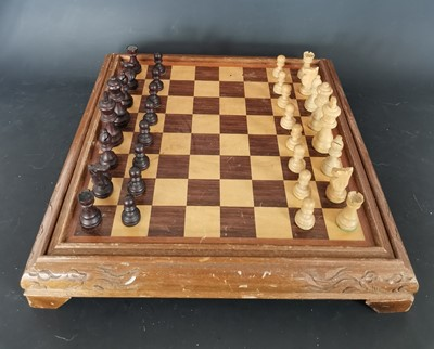 Lot 12 - A vintage wooden chess and backgammon board...