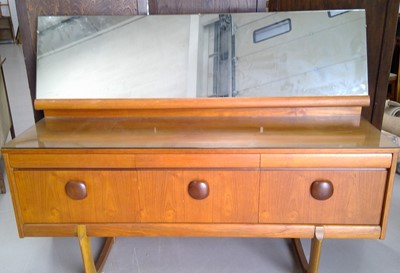 Lot 6 - A mid-century teak dressing table with six...