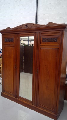 Lot 13 - A late Victorian walnut and mahogany wardrobe...