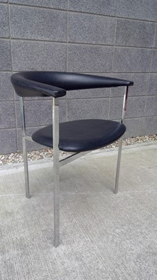 Lot 24 - A styalish chrome frame chair with a leather...