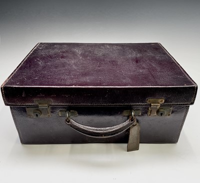 Lot 46 - A purple leather toilet case by Mappin and...