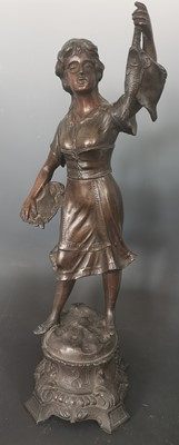 Lot 14 - A large bronzed hollow cast figure of a lady...
