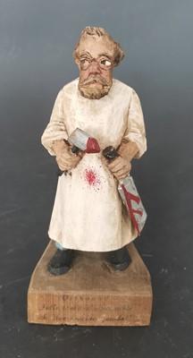Lot 20 - A vintage carved wooden figurine of a butcher...