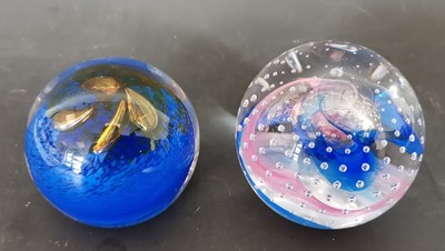 Lot 17 - Two signed Caithness glass paperweights.