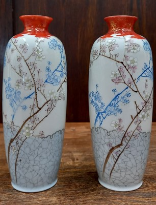 Lot 21 - A pair of Japanese vases with cherry blossom...